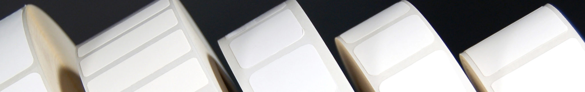 Rolls of assorted white blank labels