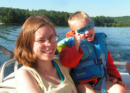 mom and son on boat