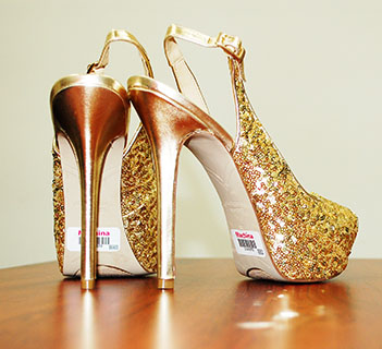 Gold colored high heels with labels